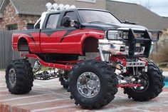 Huge red and black lifted Ford!!