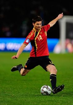 Xabi about to do a long pass