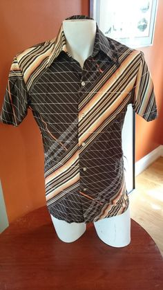 Check out this item in my Etsy shop https://www.etsy.com/listing/463405252/vintage-brown-geometric-1970s-disco