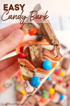 Wondering how to make chocolate bark? This Halloween Candy Bark is made with delicious chocolate, white and orange candy melts, and bejeweled with loads of candy. An amazing chocolate bark recipe! || Delightful E Made Chocolate Bark, Delicious Chocolate, Chocolate Orange, Chocolate Desserts, How To Make Chocolate, Best Dessert Recipes, Sweets Recipes, Fun Desserts, Delicious Desserts