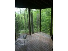 Large screened in porch, keep the bugs out, but you feel like your in the middle of the woods!