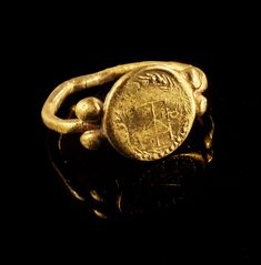 Golden ring with a monogram and a staurogram in a wreath. Byzantine, 5th - 6th century A.D.