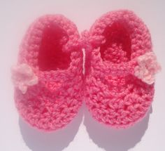 Crocheted pink double soled baby shoes, slippers, booties. Two shades of pink with flower trim. Baby gift. Baby stuff. £7.00, via Etsy.