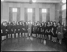 Black Greek Fraternities & Sororities     		Alpha Kappa Alpha soritority with mrs roosevelt at Howard University, 1944.Addison Scurlock, photographer.