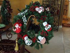 This was a tired old wreath that I breathed new life into by using the snowmen I make