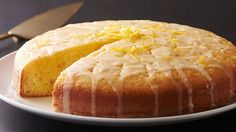 Lemon olive oil cake---A refreshing light tasting cake made with fresh squeezed lemon juice and olive oil. The lemon glaze soaks into this poke and pour cake for delightful lemon flavor in every bite. Lemon Desserts, Lemon Recipes, Köstliche Desserts, Easy Cake Recipes, Dessert Recipes, Italian Desserts, Spring Desserts, Delicious Recipes, Hash Browns