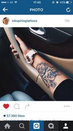 Rose tattoo lower arm