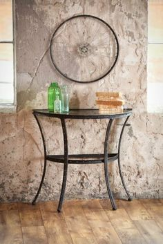 "32"" Demilune Urban Rustic Bicycle Spoke Metal and Glass Half-Circle End Table by Cape Craftsmen. $299.99. Glass and Metal Bicycle Spoke Table Item #8HTM013End table features a bicycle inspired design. A glass panel lies over bicycle spokes and is supported by metal scaffolding beams making for a surprisingly elegant end table Dimensions: 32""L x 16.5""W x 30""H Material(s): metal/glass. Save 13%!"