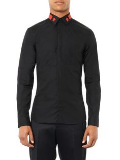 Refresh your formalwear with Givenchy's embroidered black cotton shirt. This sleek, concealed-placket design features a high-contrast collar that's detailed with a bold red stars and stripe design. RRP: £205.00 (matches fashion)