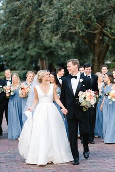 a classically beautiful wedding features bridesmaids in blue gowns, groomsmen in black tie tuxedos and flowers in pale shades of peach and pink. Black Tie Bridesmaids, Blue Groomsmen, Dusty Blue Bridesmaid Dresses, Dusty Blue Weddings, Orange Weddings, Spring Weddings, Peach Wedding Colors, Black Wedding Themes, Wedding Ideas