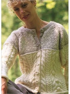 Cables, bobbles, colorwork, and crocheted buttons - all in this sporty cardigan. The lower body and sleeves are worked in a bold Aran pattern, then the yoke is worked in a subtle two-color Fair Isle pattern. A simple twisted