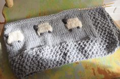 baa baa black sheep:  the source of the pattern for this blanket at the public library: the book Precious Knit Blankies for Baby by Jean Adel