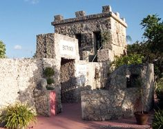 Entrance to the Coral Castle south of Miami, Florida. This large complex of carefully placed coral rocks was first built ten miles away in Florida City by Ed Leedskalnin. Leedskalnin was a master stone mason, and led a mostly private and simple life in south Florida. Though just five feet tall and one hundred pounds, he managed to quarry, sculpt, and assemble 1,100 tons of coral rock using only the simplest metal tools