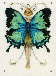 A fairy with teal and black wings from the Butterfly Misses Collection.