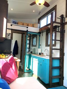 In this tiny house kitchen you'll find the home's namesake: a vintage 1940s era steel Youngstown by Mullins kitchen sink and base that has been completely restored.