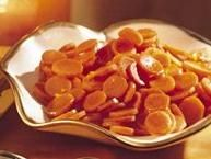 """Golden carrot """"coins"""" taste even better when coated with this buttery brown-sugar glaze."""