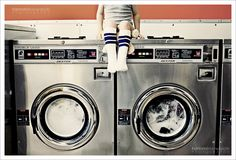 Bring a bottle of soap and quarters to the laundromat for someone