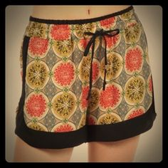 """NWT printed drawstring shorts with pockets! NWT multi colored printed shorts with elastic waistband, drawstring and pockets! Lightweight fabric. No size tag, but fits like a small. Waist is 13.5"""" laying flat, 17"""" when fully stretched. 3"""" inseam, 13"""" from waist to hem. Freeway Other"""