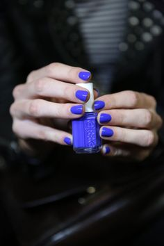 Vibrant blue nails in a classic short shape at Reed Krakoff: http://beautyeditor.ca/2014/09/17/reed-krakoff-spring-2015-nails