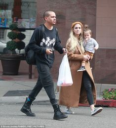 Close: The 32-year-old was spotted carrying her 18-month-old daughter Jagger in her arms, while husband Evan Ross kept pace alongside