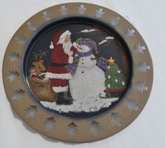 I painted this Santa and Snowman design on a tin plate.