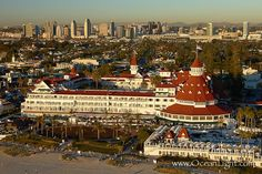 Hotel del Coronado, known affectionately as the Hotel Del. It was once the largest hotel in the world, and is one of the few remaining wooden Victorian beach resorts. It sits on the beach on Coronado Island, seen here with downtown San Diego in the distance. It is widely considered to be one of Americas most beautiful and classic hotels. Built in 1888, it was designated a National Historic Landmark in 1977. San Diego, California, USA