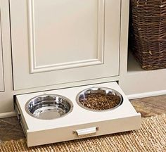 Save space by incorporating the dog bowl into a toe kick slide-out!  This concept gets even better yet - the cabinet door is actually the door to a built in dog crate (ventilation holes are at the top).  Make your Black Hills dream home a reality. Contact the folks at CustomHomesbyJScull.com today!