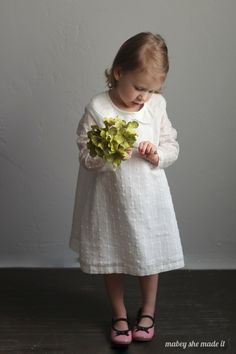 This Norah dress upcycle turns a curtain panel, a bed sheet, and vintage lace into a trendy fashion magazine inspired creation.