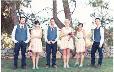 groomsmen in jeans and vests
