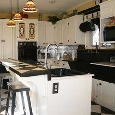 white with black countertops and black appliances. Hmmm....