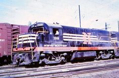 A pair of New Haven U25B's appear to be somewhere along the electrified main line between New Haven, Connecticut and New York during the latter 1960s