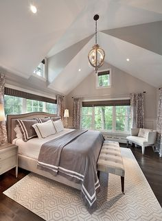 Love this master bedroom, how open and spacious. the tall ceilings really give it a good vibe. Feels like a treehouse with all those windows!