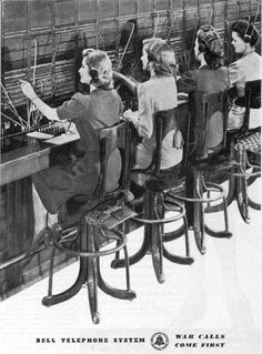 "A typical telephone-exchange switchboard, ca. 1943.  ""War calls come first."""