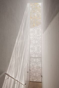 | MODERN + WHITE | #Perforated - Kidergarden-Cerdanyola-del-Vall-S - lovely vertical screen detail to filter natural daylight into an interior #gaileguevara #loves alternative ways to illuminate interiors with natural daylight where ever possible
