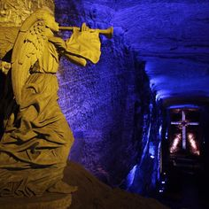 Photo by @ErikaSkogg // A sandstone angel stands over the world's largest underground cathedral carved completely out of an old salt mine in #Zipaquira #Colombia #CatedraldeSal #SaltCathedral by natgeotravel