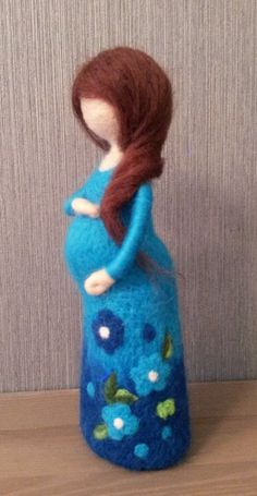Needle felted waldorf inspired standing doll. She is about 7 tall. Her dress is decorated with flowers. You can change possition of her hands. Made to order, you can choose color of her dress. She can make someone happy as a present, be a nice home decoration. Thank you for #feltdolls