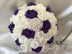 These statement making, outstanding bouquets are made up of cadbury purple & ivory foam roses. These truly beautiful bouquets will not go unnoticed on your