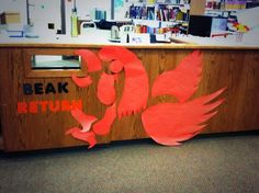 """""""Beak"""" Return.... library puns!  South East Junior High School Library in Iowa City... home of the Little Hawks!"""