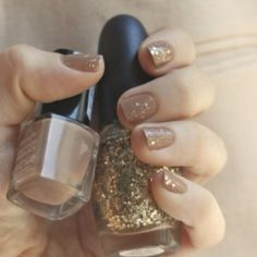 Nude and gold specked nails. Perfect for any occasion ;) haha