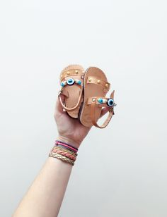 Double Strap Evil Eye Sandals - Child Greek Summer Leather with Gold Studs and Beads by KandElphy on Etsy https://www.etsy.com/listing/482273867/double-strap-evil-eye-sandals-child