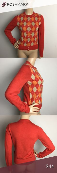 "JCrew Argyle Orange Merino Wool Crewneck Cardigan New without tags.CHECK OUT MY OTHER ITEMS THAT I HAVE LISTED AT A GOOD PRICE, I UPDATE MY LISTINGS DAILY!!!! ALL MEASUREMENTS ARE TAKEN WITH GARMENT LYING FLAT: SLEEVES: 25"" BUST: 16.5"" WAIST: 15"" LENGHT: 21 J. Crew Sweaters Cardigans"