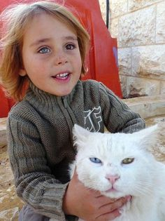 Afghan girl and her cat…