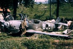 A G.I. stands beside an abandoned BF109k4