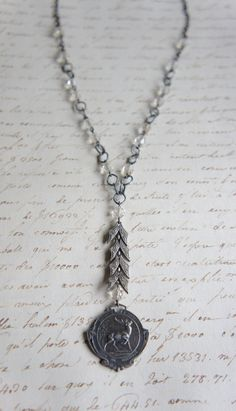 Vintage St. Hubert medal necklace with art deco links and vintage vintage crystal beads by French Feather Designs.