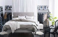 Clothes storage hidden behind a curtain - IKEA Bedroom Design Ideas 2013 Catalogue