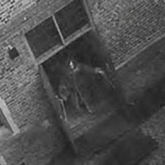Possible image of a ghost captured on a surveillance camera at Hampton Court Castle in England in October of 2003. The security team at the castle kept finding the fire doors left open and were going through the CCTV tapes to figure out who might have been responsible when they found this image. The area was not used by the staff, and no one knows who might have been in the castle—and dressed in period costume—who might have been responsible for the image.