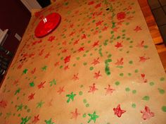 Kid Christmas Craft.  Wrapping paper from kraft paper and potato stamps.