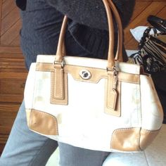 Authentic Coach purse Roomy handbag...perfect for spring and summer...is worn and lining is not like new. Coach Bags
