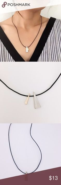 """Handmade Trendy Contrast Triangle Cord Necklace Handmade geometric triangle necklace on black cord. Part of my new Geo Capsule, this necklace is simply timeless. Contrast between the matte gold and silver triangles of different sizes gives this piece a sleek style that'll make you want to wear it everywhere. Shines from every angle and the black cord makes it comfortable to wear. Can match with any of your casual outfits! Spring clasp and length of approximately 18"""". From a smoke-free…"""