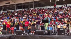 NZ Ukulele Festival - Paradise being performed by close to 3000 children on ukulele with special guest James Hill - Maria Winder leading. Months Song, Special Guest, Ukulele, Life Is Beautiful, Singing, Paradise, Let It Be, Songs, Children
